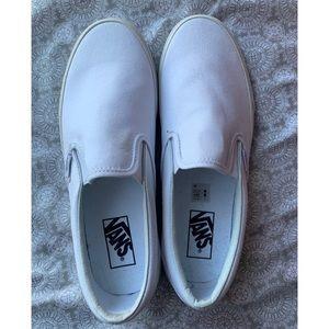All white slip on vans